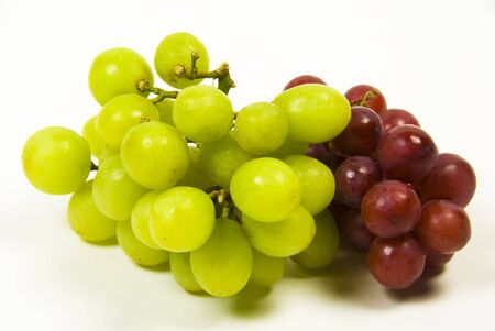 seedless: large bunch of ripe green and red juicy seedless grapes