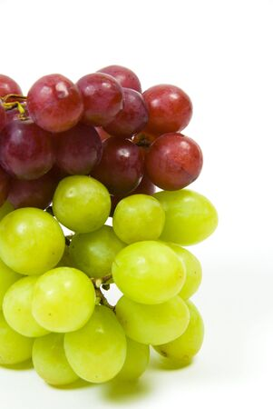 large bunch of ripe green and red juicy seedless grapes photo