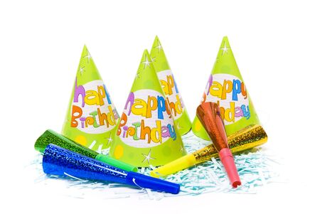 party hats and paper horns on a white background Stock Photo - 4151030