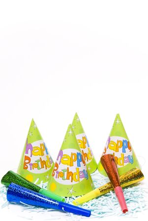 party hats and paper horns on a white background Stock Photo - 4151026