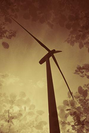 windturbine met boom en blad achtergrondkleur Stockfoto