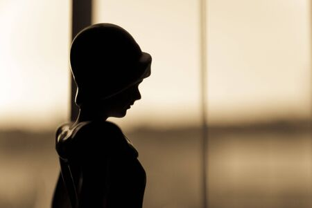 profile of old fashioned sepia woman in window