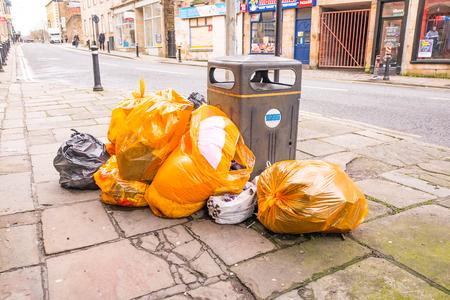 garbage bags on street in lancaster england