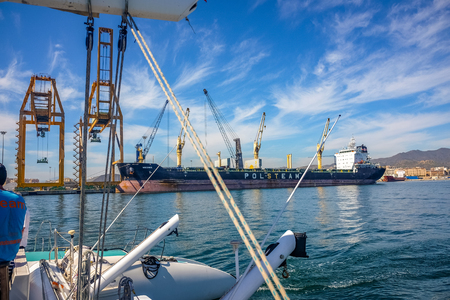 Ships moored in malaga harbor. Malaga, andalusia Spain Editorial