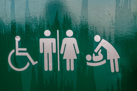 Toilet Sign Restroom, Mother room and Disabled sign green with silver figures Stock Photo
