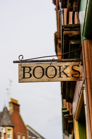 old fashioned wooden bookshop sign Stock Photo