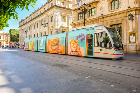 Modern tram in the central downtown area of Seville.