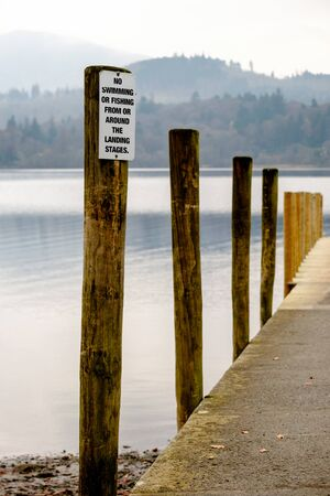 Jetty Posts On The Lake Shore at Derwentwater Imagens