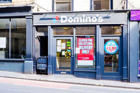 UNITED KINGDOM, LANCASTER - 9TH APRIL 2020 Domino's Pizza takeaway in city centre during lockdown