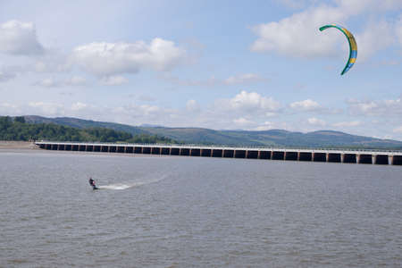 Arnside UK 24 May 2020 Kite Surfer and Railway viaduct at Arnside on a very windy day