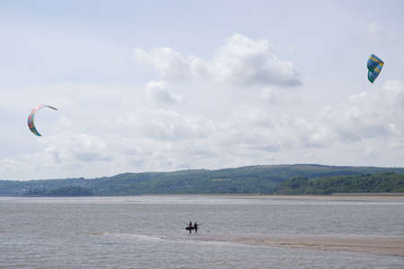 Arnside UK 24 May 2020 Kite Surfers at Arnside on a very windy day