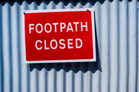 footpath closed red warning sign in Kendal UK