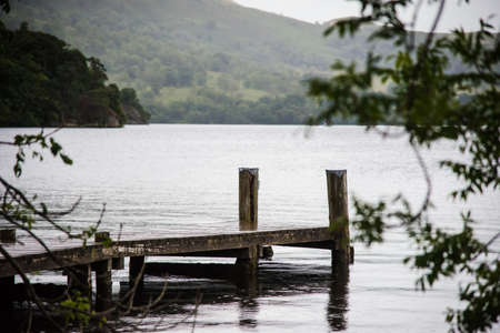 view of stormy skies and jetty north east across ullswater from glenridding