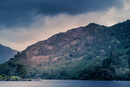 view of stormy skies north east across ullswater from glenridding