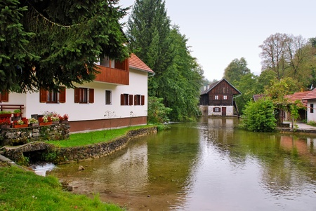 holidays vacancy: View of houses and river at Slunj - Croatia