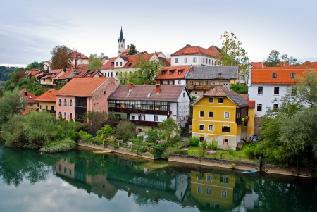 holidays vacancy: Viev of Novo Mesto riverside from bridge - Slovenia Stock Photo