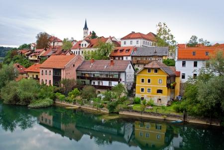 Viev of Novo Mesto riverside from bridge - Slovenia Stock Photo