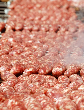 chorizos: Big Argentinean cow and pig barbecue sausages Stock Photo