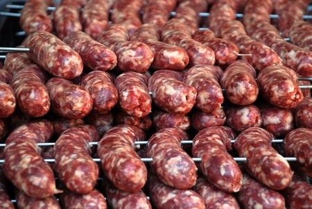 Big Argentinean cow and pig barbecue sausages Stock Photo