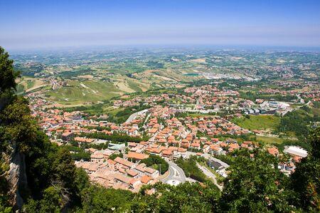 Postcard up view of town and hills at Repubblica di San Marino