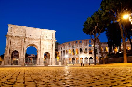 Night view of Colosseum and Constantine Arc at Roma - Italy Stock Photo