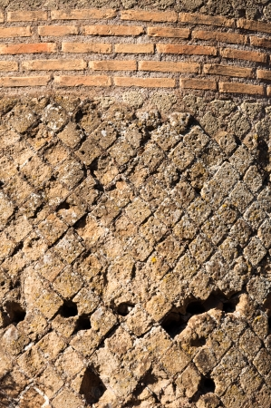 Details of ancient roman bricks wall at Villa Adriana Vertical view at Roma - Italy photo