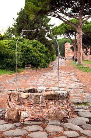 Well on old roman stony street at Ostia Antica - Rome - Italy photo