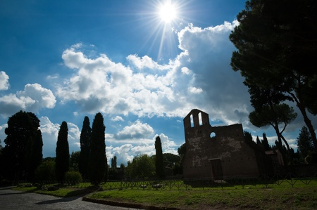 bove: San Nicola a Capo di Bove church at Via Appia antica backlight with shiny sun on blue sky - Rome - Italy Stock Photo