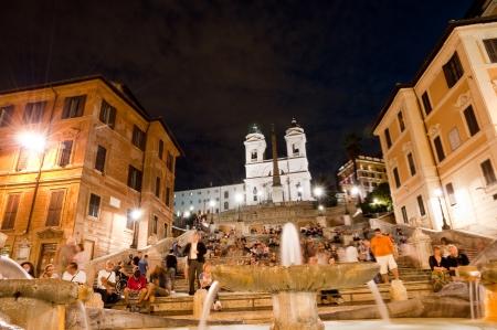 trinita: Piazza di Spagna night life fountain close and Trinita dei Monti Editorial