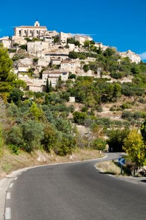 gordes: Street leading to Gordes village - France Stock Photo