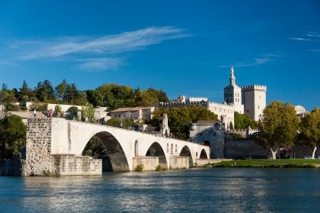 avignon: Pont du Avignon over Rhone river - Palais des papes and Notre dame des dome cathedral at Avignon - France
