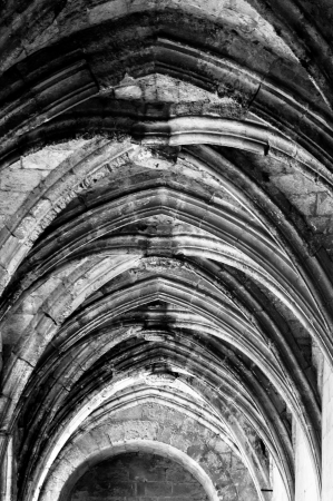 arcs: Cloister ceiling arcs at Saint Just Cathedral at Narbonne - France - Vertical Stock Photo