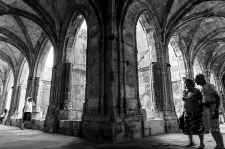 corridors: Cloister corridors and arcs at Saint Just Cathedral with tourists at Narbonne - France - horizontal
