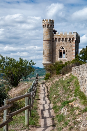 Magdala tour and fenced path at  Rennes le Chateau in france Editorial