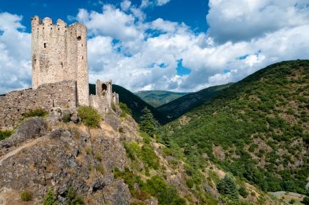 La Tour Regine and Cabaret towers on mountains landscape at Lastours in France