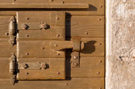 adriatico: Detail of ancient wooden door Stock Photo
