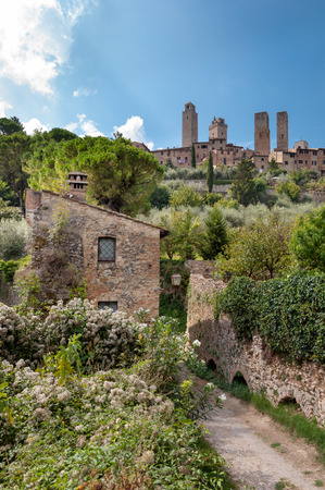 surroundings: Natural surroundings and town towers at San Gimignano - Italy Stock Photo