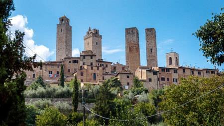 surroundings: Towers and houses natural surroundings at San Gimignano  - Italy