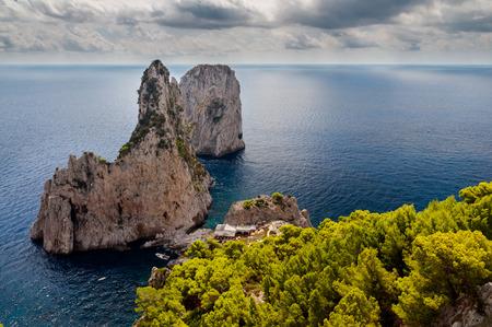 Faraglioni and sea with stormy sky at Capri - Italy