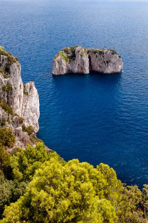 Stone islands and cliff on Capri coast - Italy
