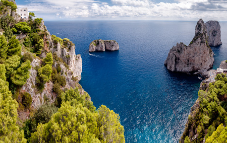 tyrrhenian: Great view of Faraglioni Tyrrhenian sea and Capri island cliff at Capri - Italy Stock Photo