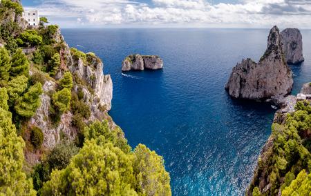Great view of Faraglioni Tyrrhenian sea and Capri island cliff at Capri - Italy Stock Photo