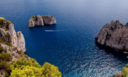 Stone islands and sea on Capri coast - Italy