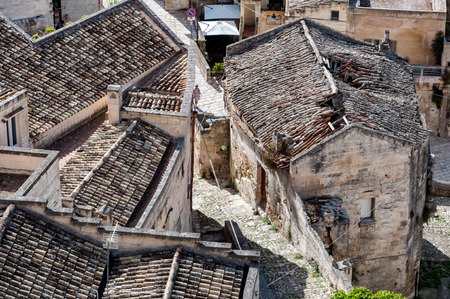 MATERA, ITALY – SEPTEMBER 15, 2014: Old rooftops in ancient Sassi di Matera. The city is a UNESCO World Heritage site and European Capital of Culture for 2019