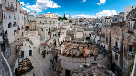 MATERA, ITALY – SEPTEMBER 15, 2014: Panoramic view of Sassi di Matera from Piazza Vittorio Veneto. The city is a UNESCO World Heritage site and European Capital of Culture for 2019