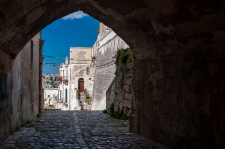 unesco culture heritage: MATERA, ITALY – SEPTEMBER 15, 2014: Passage and buildings in ancient town Sassi di Matera. The city is a UNESCO World Heritage site and European Capital of Culture for 2019