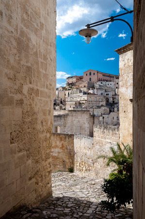 rupestrian: Passage with lantern and view of buildings of Sassi di Matera - Italy