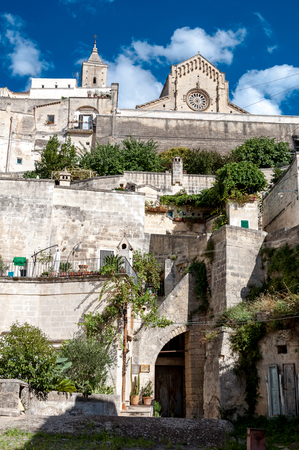 MATERA, ITALY – SEPTEMBER 15, 2014: Street view of ancient town Sassi di Matera and Duomo. The city is a UNESCO World Heritage site and European Capital of Culture for 2019 Editorial