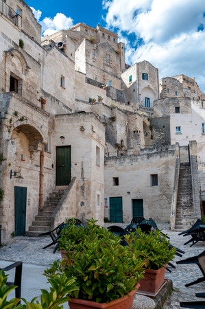 unesco culture heritage: MATERA, ITALY – SEPTEMBER 15, 2014: Street view of buildings in Matera ancient town Sassi di Matera. The city is a UNESCO World Heritage site and European Capital of Culture for 2019