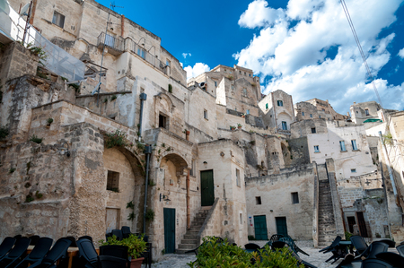 MATERA, ITALY – SEPTEMBER 15, 2014: Street view of buildings in Matera ancient town Sassi di Matera. The city is a UNESCO World Heritage site and European Capital of Culture for 2019 Editorial